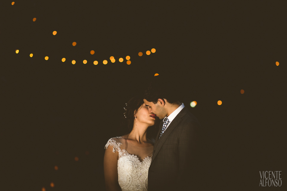 Bride kissing groom with bokeh